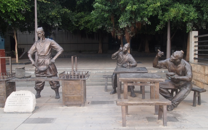 Statues along the river walkway