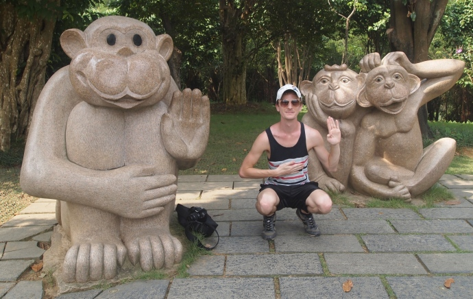Caleb poses with the monkeys