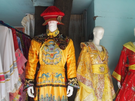 costumes for sale on the perimeter of the petting zoo