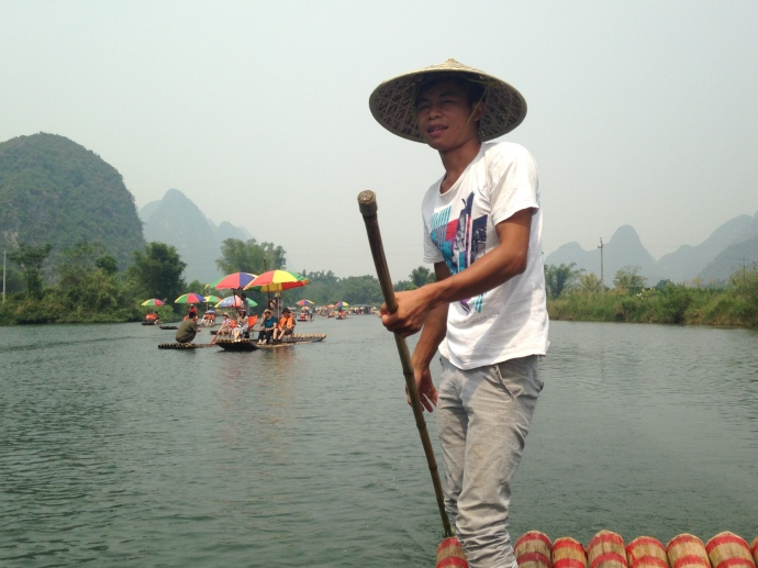 my boatman in his conical hat