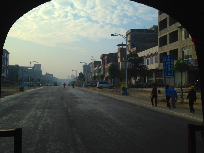 view of Daxin from the back of the three-wheel taxi