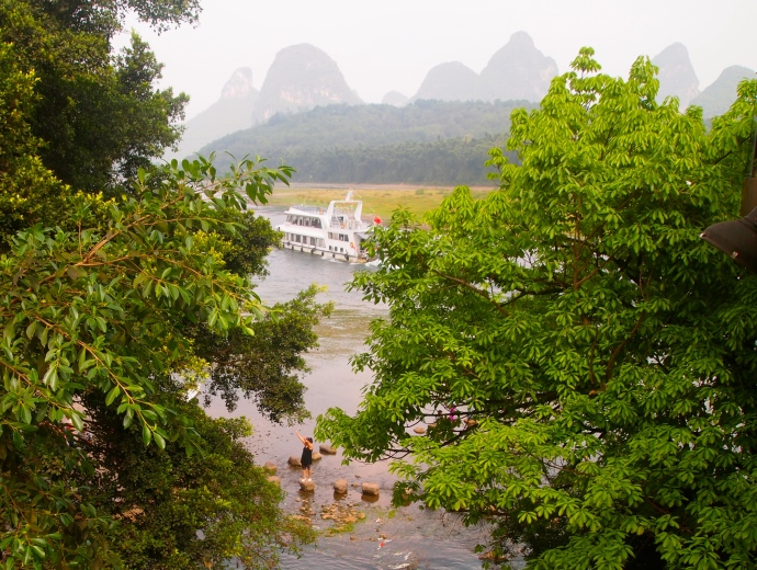 peeking through trees at the Li River