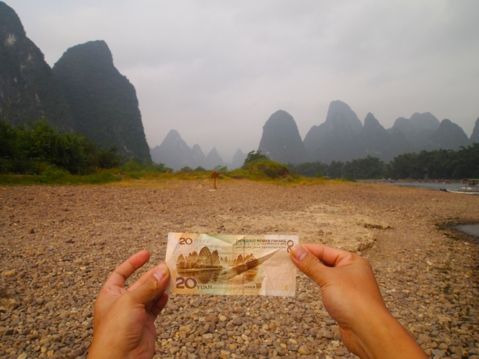 I snap this shot of the male Chinese boat mate holding the 20 yuan bill