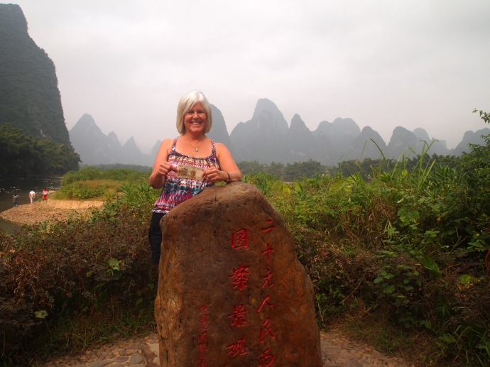 me in Xingping, holding the 20 yuan note depicting Xingping's landscape
