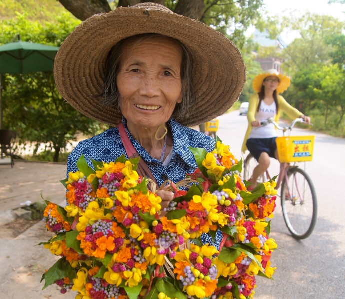 Chinese lady selling flower wreaths