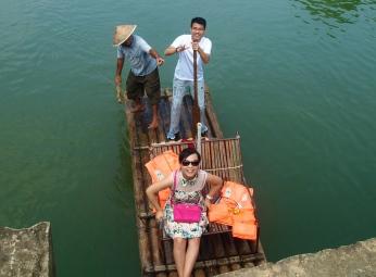 a couple floats past under the bridge