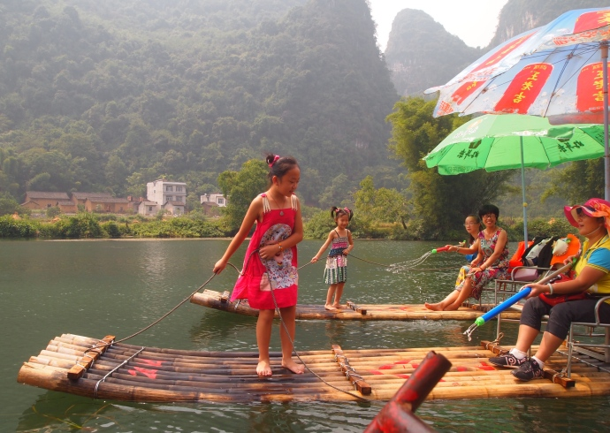 Little girls stand on their rafts