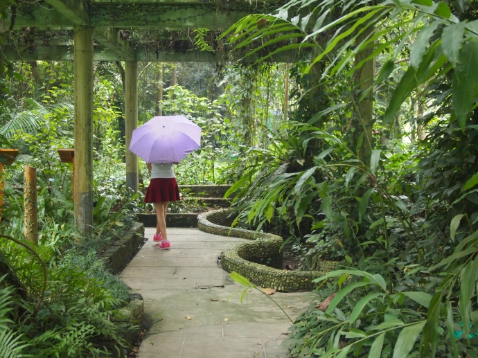 girl with umbrella on curvaceous path