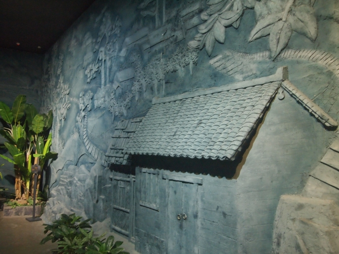 relief carving of ethnic house and farm