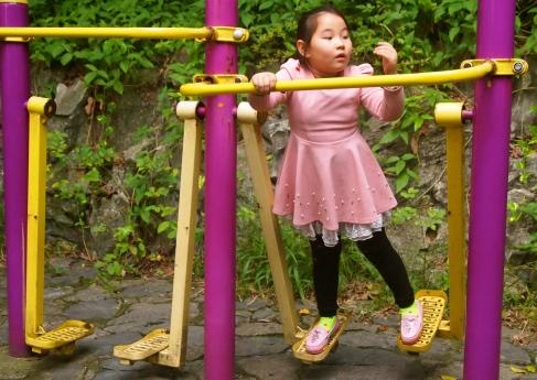 a little girl on an elliptical