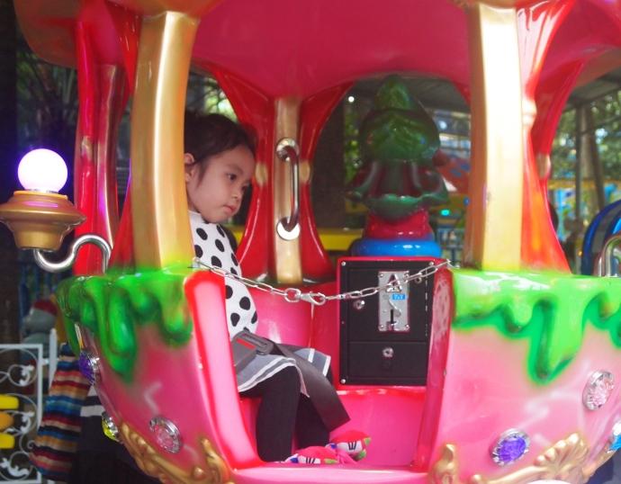 Girl on an amusement park ride