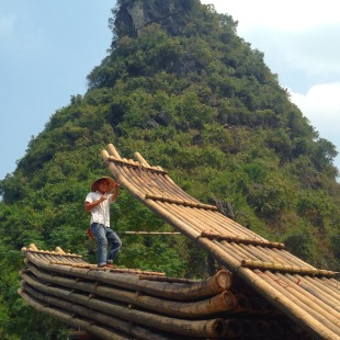 Guy loading bamboo boats at Dragon Bridge