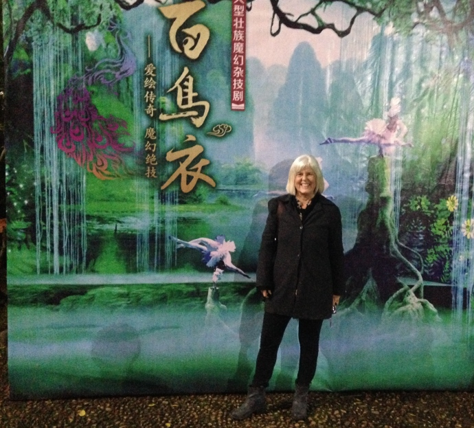 me in front of the poster for the acrobatics show in Nanning