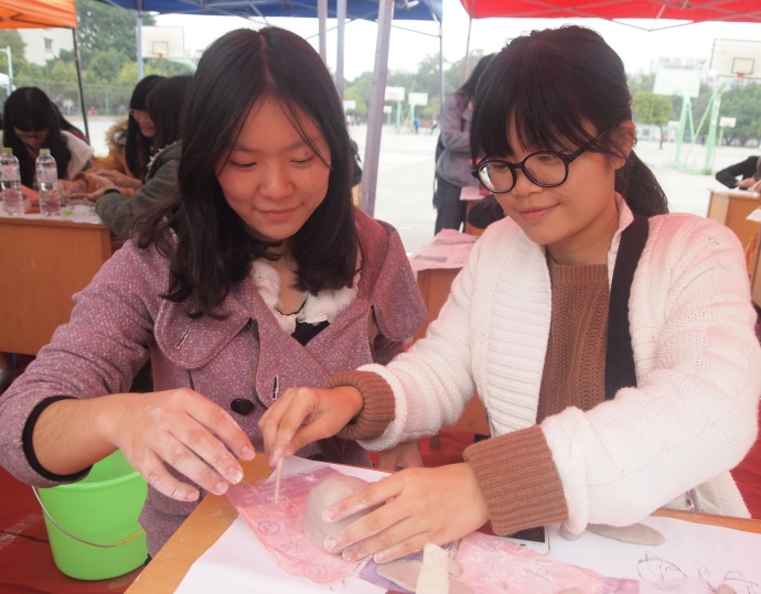 My students Eva and Fiona (who was moved out of my class), making Ming china pottery replicas!