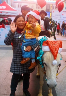 a Christmas pony and some random Chinese folks