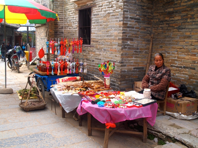 Villager selling goods on Jinma Street