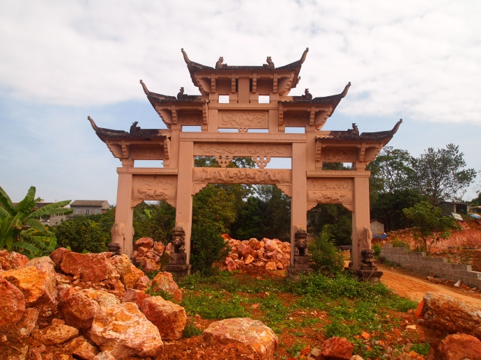 gate surrounded by reddish stones