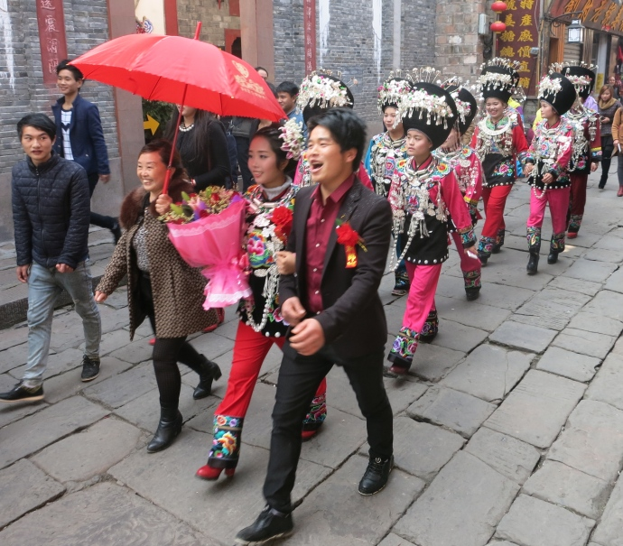 a wedding in the streets of Fenghuang