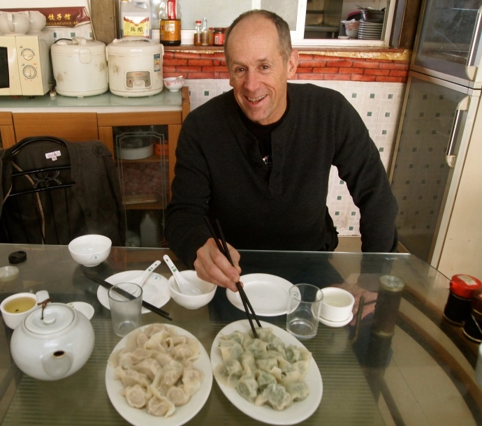 Mike eats dumplings at the Red Sign