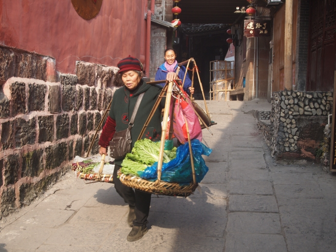 Hard at work in the streets of Fenghuang