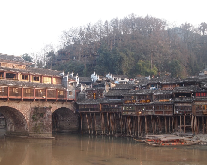 View of stilted buildings from the other side of the Tuo Jiang River