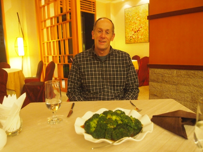 Mike orders steamed broccoli and gets a huge plate of it.