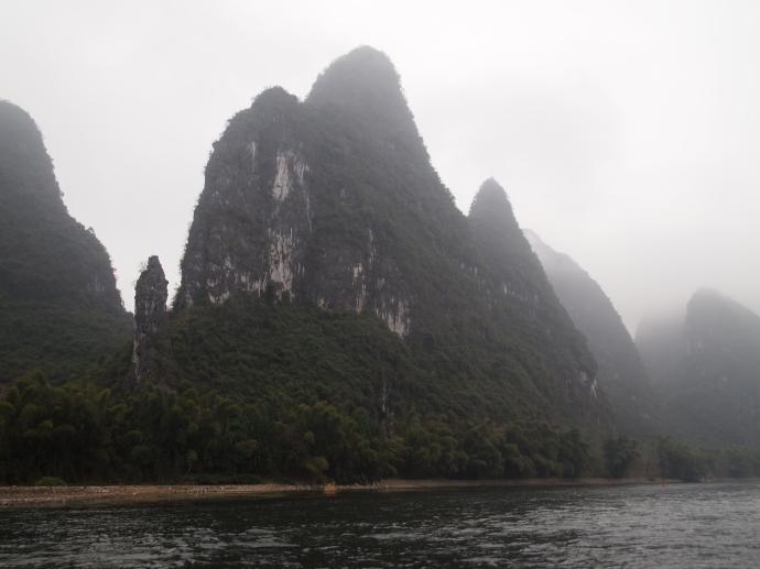 a river surrounded by karst landscape