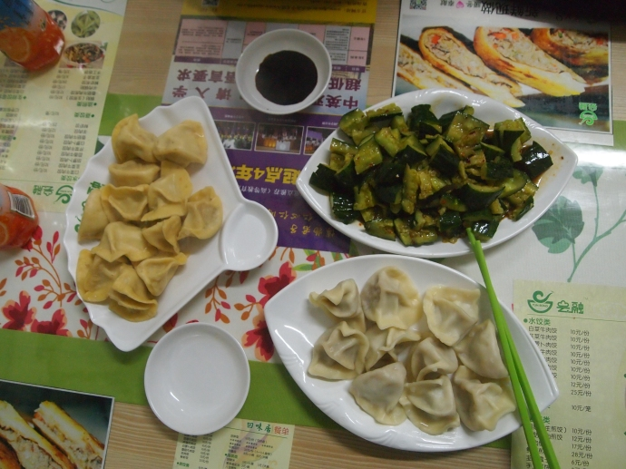 Our meal - beef dumplings with Chinese chives, beef dumplings with carrot, and cold cucumber salad