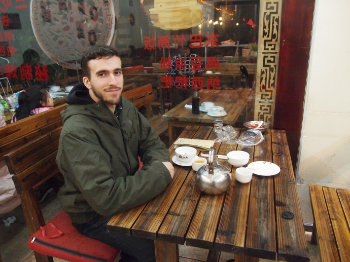 Alex at the restaurant in Lijiang