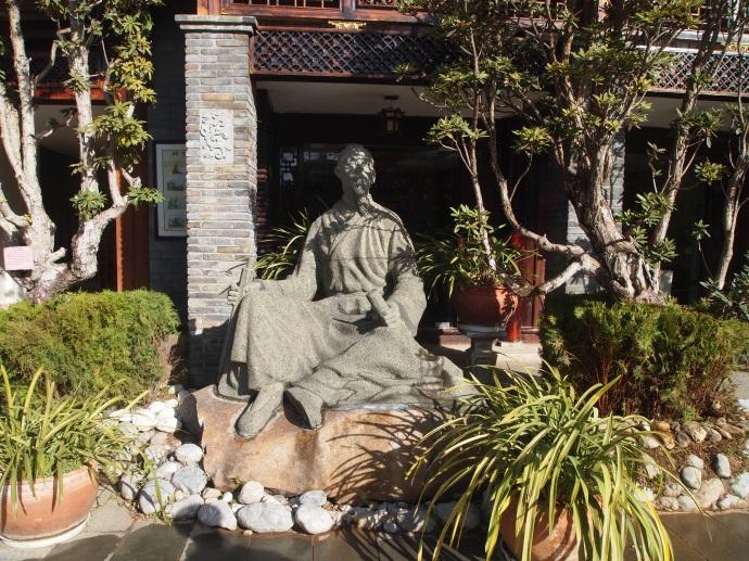 statue in a garden in Lijiang
