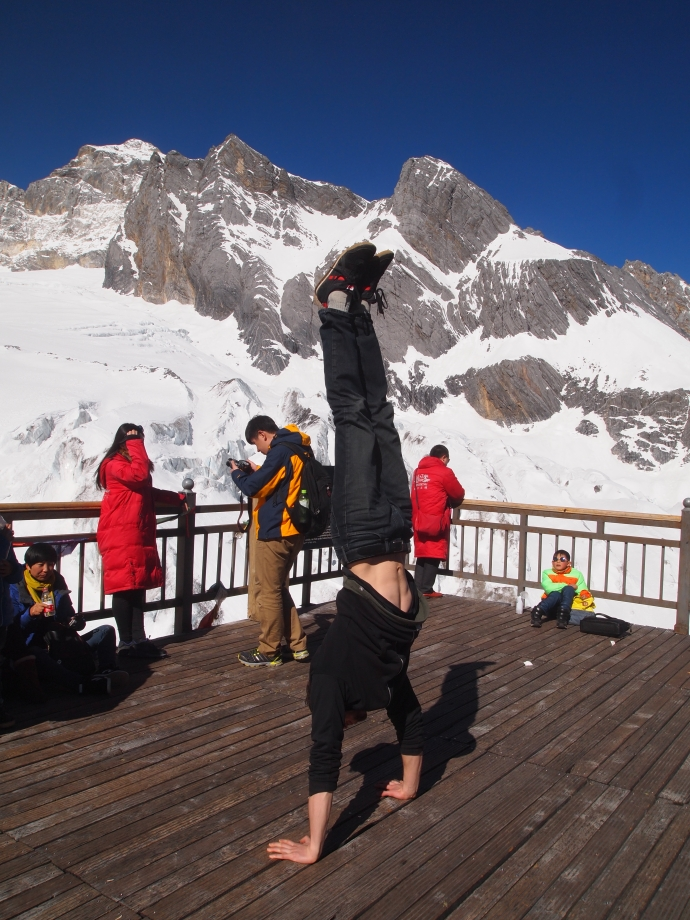 Alex does a handstand at the top