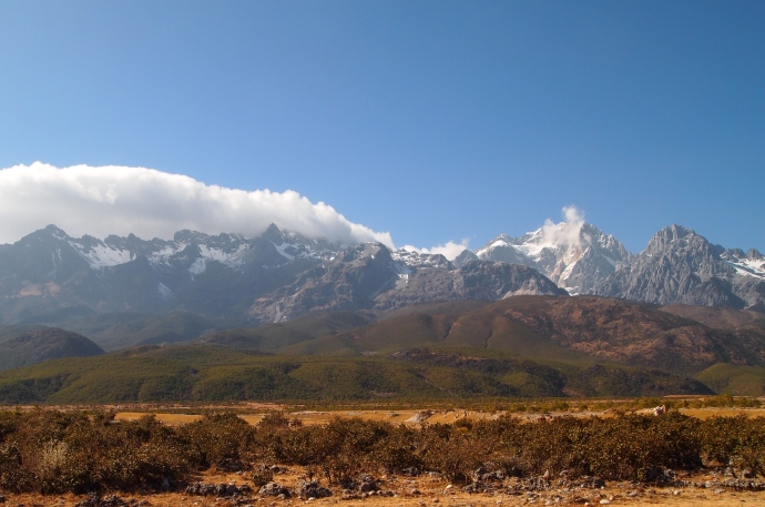 clouds nestle into Jade Dragon Snow Mountain