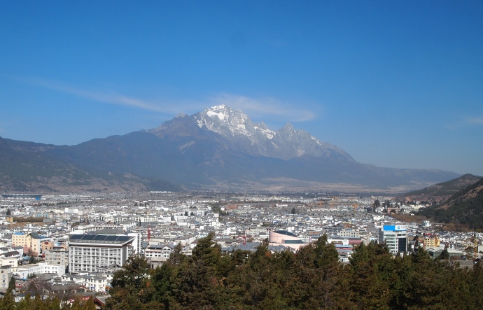 view of Jade Dragon Snow Mountain and the newer town of Lijiang from Wangu Pavilion