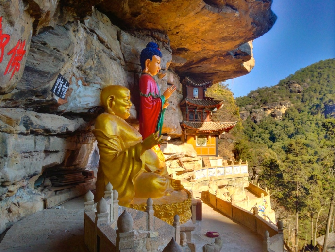 Guanyin and Maitreya, the smiling Buddha, on the cliff ledges at Baoxiang Temple
