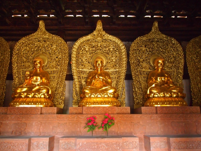 Three of the five Buddhas in Da Xiong Bao Dian
