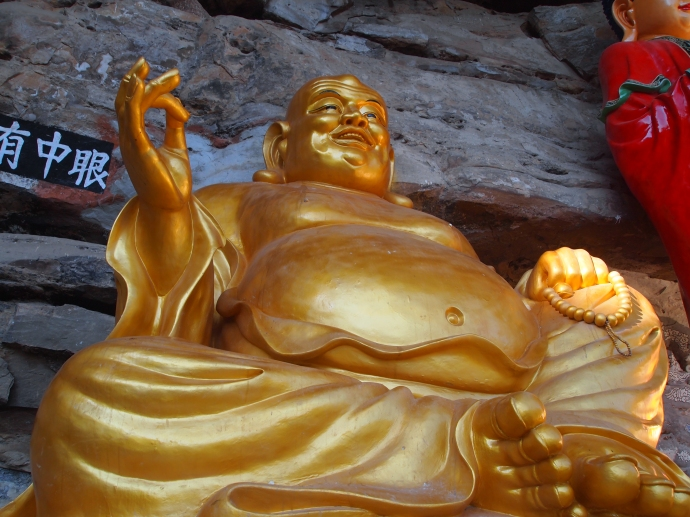 Maitreya, the smiling Buddha, on the cliff ledges at Baoxiang Temple