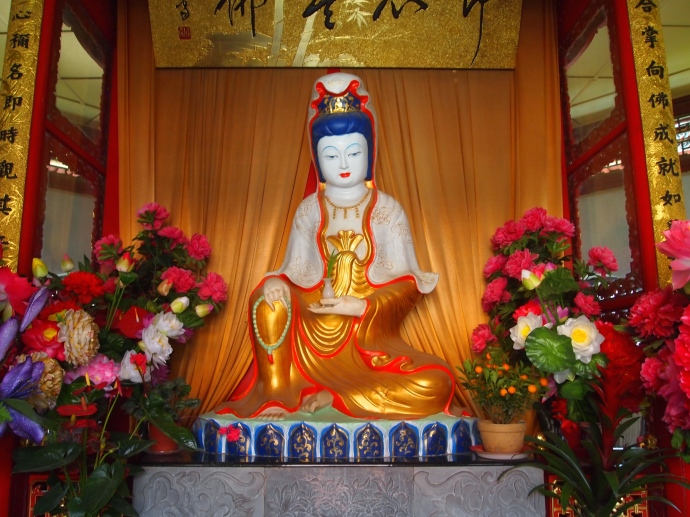 a white marble Sakyamuni in the octagonal pavilion