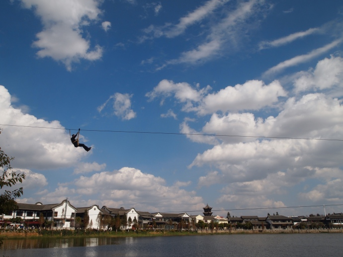 Alex zip-lines across the lake