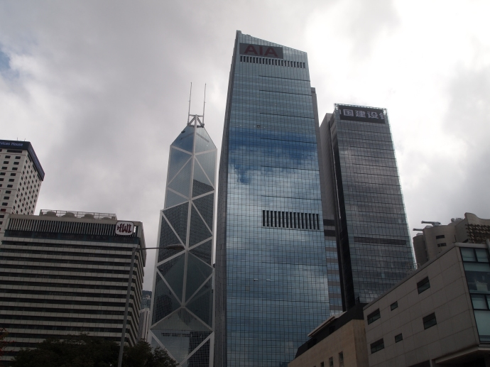 The criss-crossed building is Bank of China