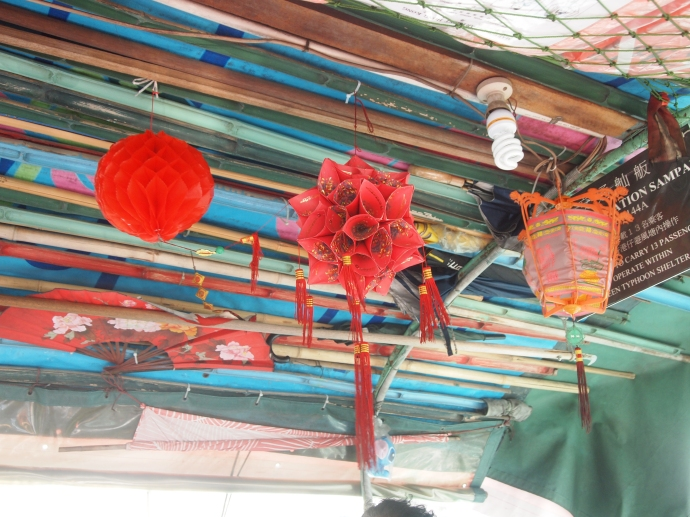 inside the sampan, looking up at the ceiling