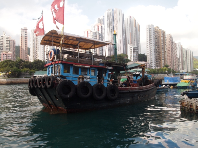 old boat and new high-rises