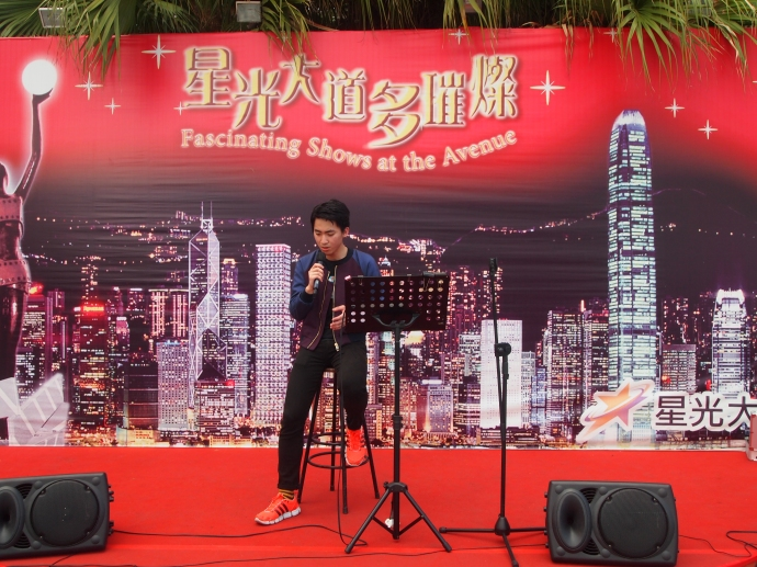 a performer belts out a song at Avenue of the Stars
