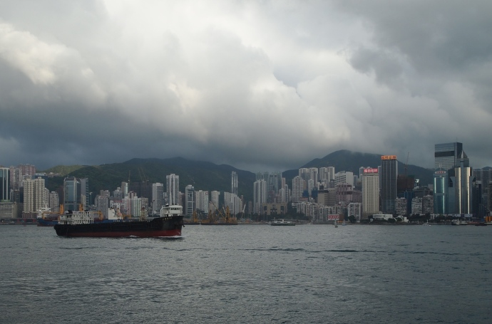 Boats under the clouds in Victoria Harbour