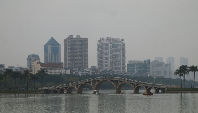 the bridge in the park with Nanning behind