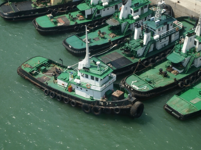 Green boats beneath the Ngong Ping Cable Car