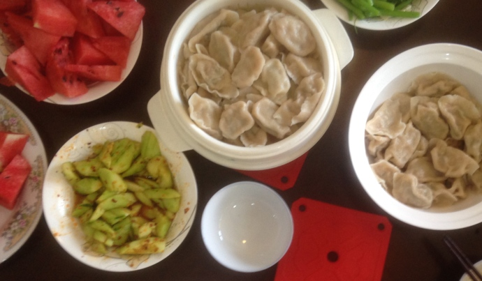 Clockwise from bottom left: spicy cucumbers, watermelon, dumplings