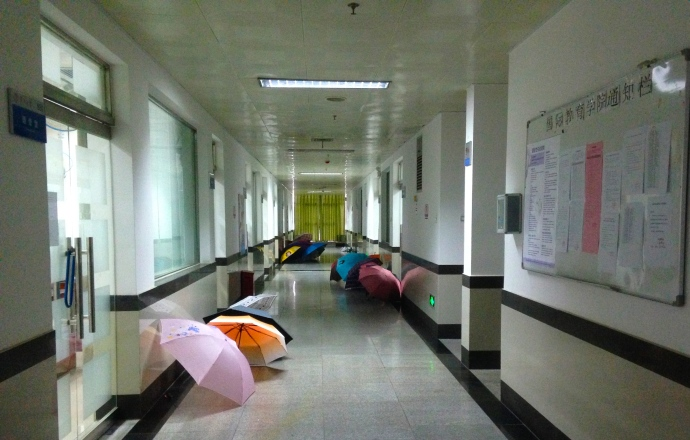 Umbrellas in the hallway of the 9th floor of the Experimental Building - this is Nanning :-)