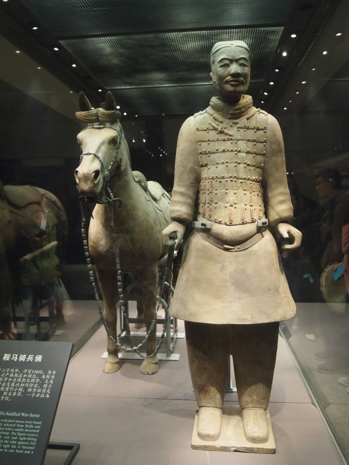 Cavalryman with his saddled war horse