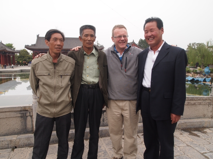 Three Chinese men wanted to pose with Andrew
