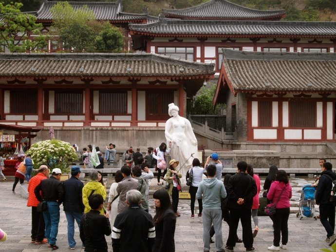 statue of the concubine Yang Guifei, surrounded by Chinese tourists